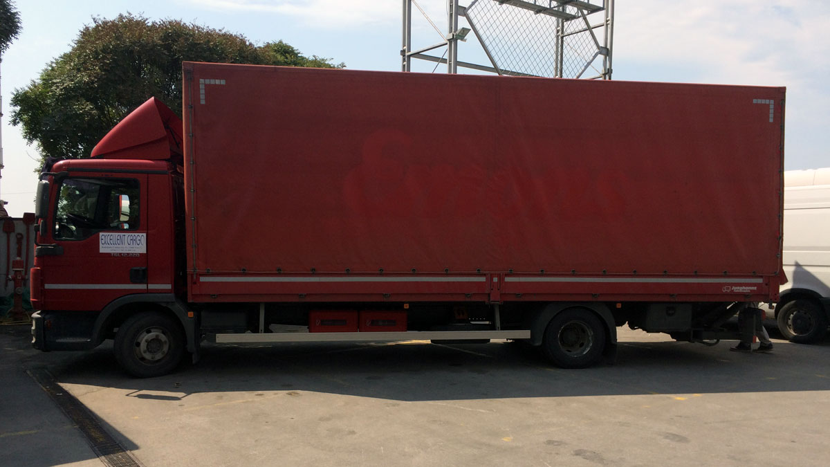 Loaded truck with packed custom made elements for Di Perna Parrucchieri Rome