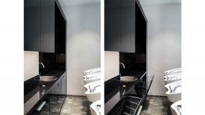 Custom made black hairwashing kitchen element with inbuilt baskets in Di Perna Parrucchieri Rome shop