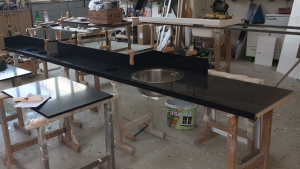 Custom made quartz working surface element for Di Perna Parrucchieri Rome in a workshop